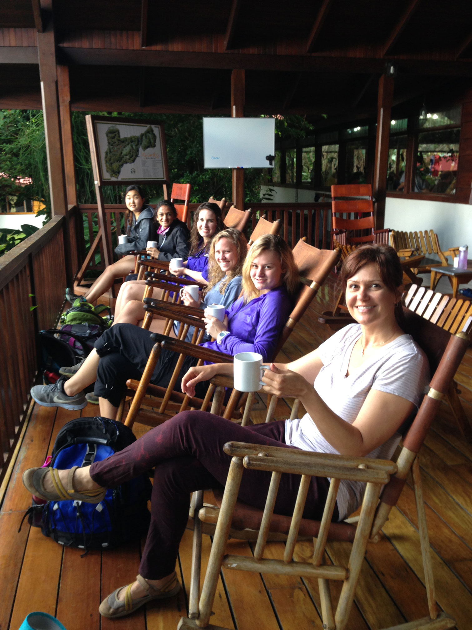Students And Assistant Professor Anne Marie Zimeri, Far Right, Rock On The  Front Porch Of The Uga Costa Rica Student Union And Enjoy Hot Chocolate  From Cows